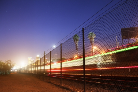 Long exposure shot of train moving towards downtown Los Angeles at night. Copyspace. photo