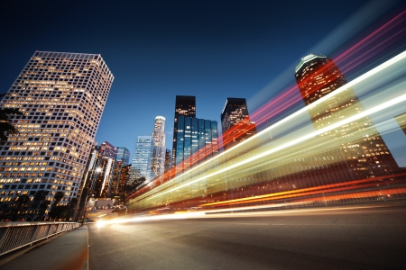 Los Angeles at night. Long exposure shot of blurred bus speeding through night street. photo