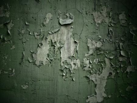 Old paint peeling off concrete wall background texture photo