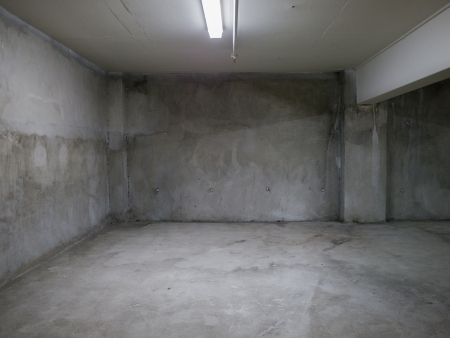 Empty gray concrete room interior.