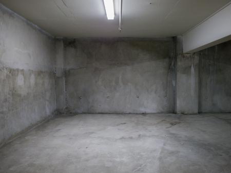 abandoned room: Empty gray concrete room interior.