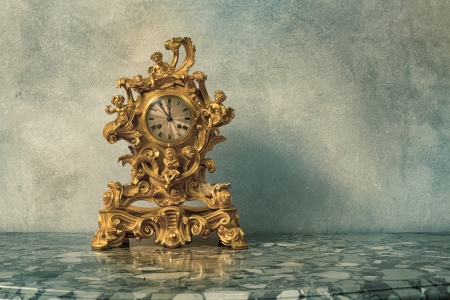 Vintage golden clock on grunge background  photo