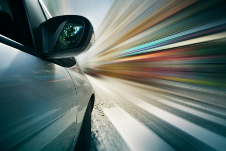 car driving: POV shot of car driving in city  Blurred motion  Stock Photo