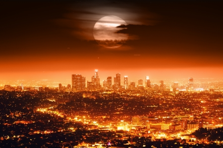 hollywood   california: Dramatic full moon over Los Angeles skyline at night. Stock Photo