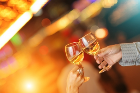 Celebration. Hands holding glasses making toast.