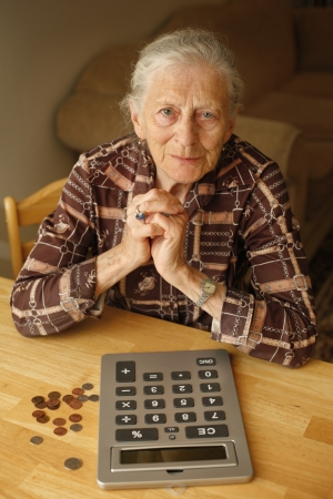 alone person: Portrait of senior woman with money and calculator