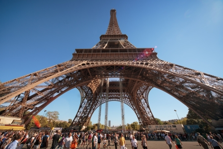 Eiffel Tower, wide angle view with crowds of people around. Paris, Europe.