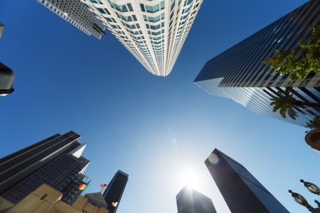 view from below: Los Angeles skyscrapers over blue sky background, wide angle view from below.
