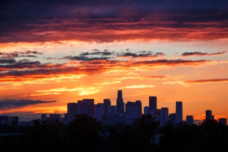 Fiery sunrise clouds over downtown Los Angeles city skyline. Stock Photo