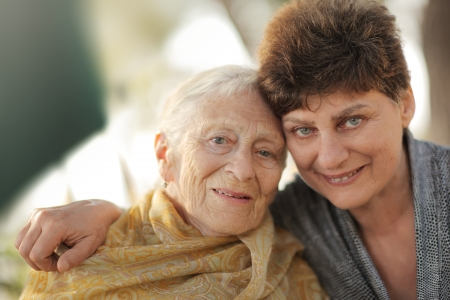 mid adult couple: Portrait of happy old grandmother with daughter, closeup.