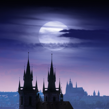 Full moon over Prague castles skyline at night. photo