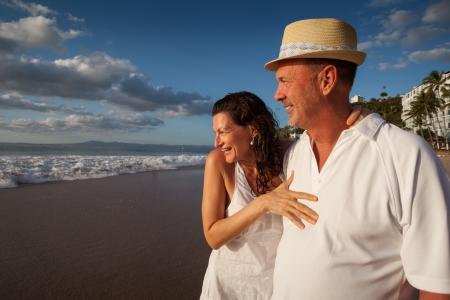 fedora hat: Mature senior adult couple together on tropical beach