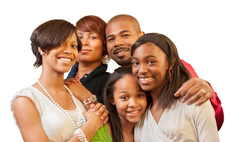 Happy African American family with teenage kids smiling on white background