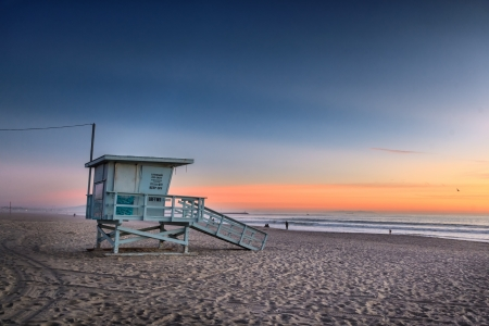 Lifeguard tower at Venice Beach, California at sunset. photo