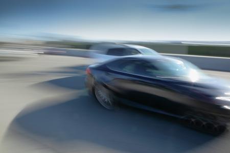 Cars speeding on city road. Blurred motion. photo