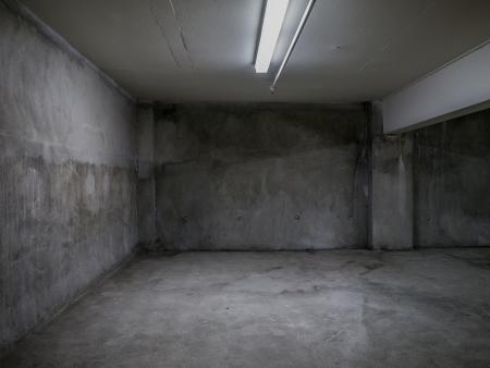 Grunge concrete room interior with empty walls