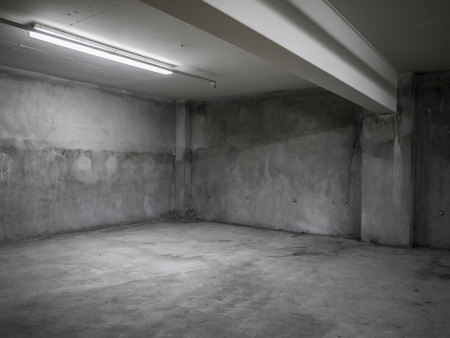 underground: Empty grey concrete industrial room interior.