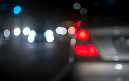 headlights: City blur background. Bokeh circles of  night traffic. Stock Photo