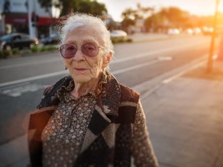 Portrait of senior woman on city street, closeup.