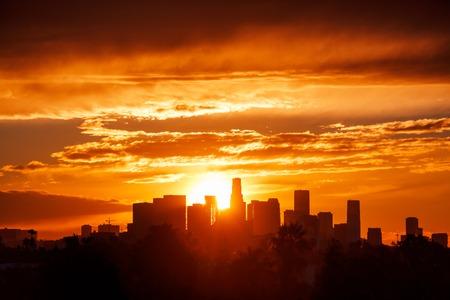 red sun: Los Angeles city skyline sunrise. Stock Photo