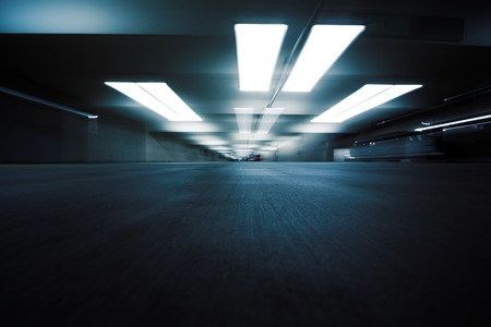 Dark parking garage industrial room interior. Zoom blur perspective. Stockfoto