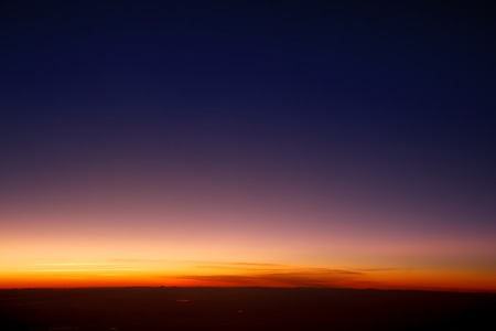 reveille: Sunset sky stratosphere background, pictured from plane.