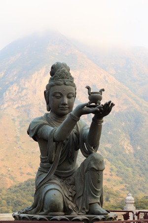 Buddhistic statue praising and making offerings to the Tian Tan Buddha. Lantau Island, Hong Kong, China.