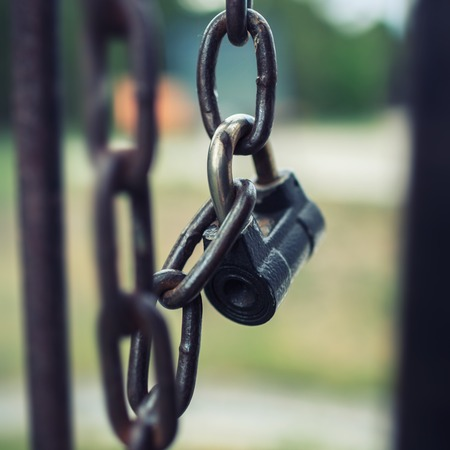 locked up: Padlock lock locked on chain gate. Stock Photo