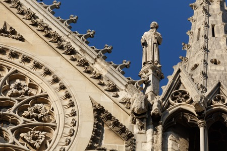 Architecture detail with statue. Notre Dame Cathedral, Ile de la Cite, Paris, France