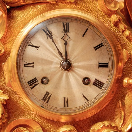 Vintage antique golden clock face, closeup.