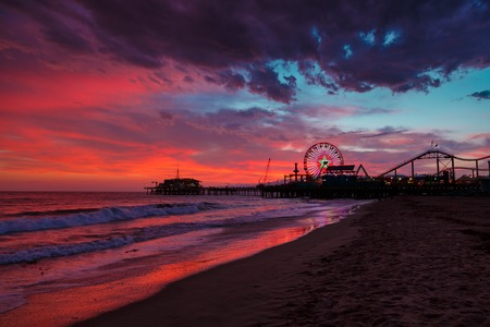 Santa Monica Pier Ferris Wheel over sunset sky background. Los Angeles, California.