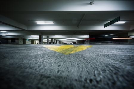 Grunge garage parking industrial room interior.