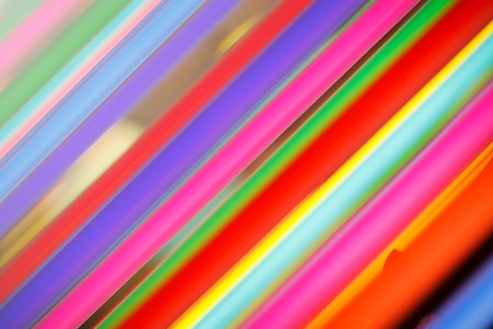 tilted: Abstract background of colorful neon lights.