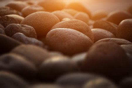 Pebble zen stones in garden at sunset. Closeup.