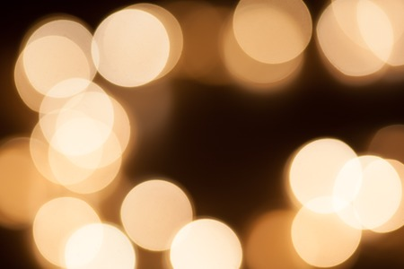 Yellow bokeh circles abstract background