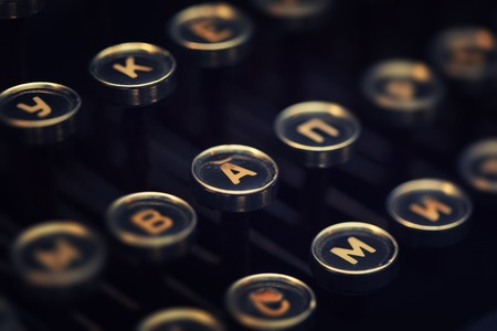 Vintage typewriter keyboard macro closeup. Shallow DOF, focus on letter A.