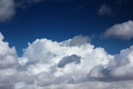White puffy clouds over blue sky background 版權商用圖片