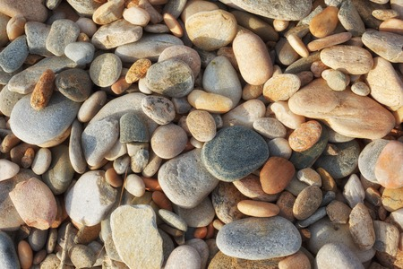 Smooth pebble stones background texture photo