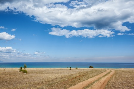 Serene landscape with Baikal lake under blue sky background.