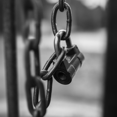 locked: Padlock lock locked on chain gate. Stock Photo