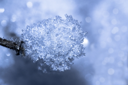 glistening: Glistening ice crystals lie on the background of the snow surface