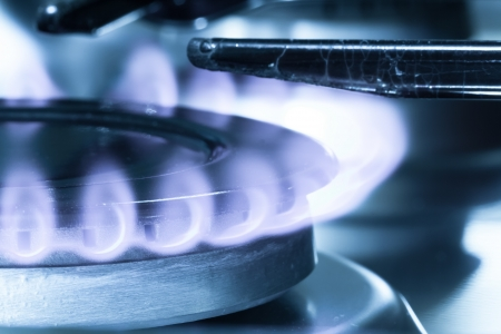 Flames of gas stove close-up shot. Natural gas photo