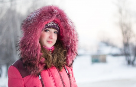comely: Beautiful young girl went for a walk on a winter day Stock Photo