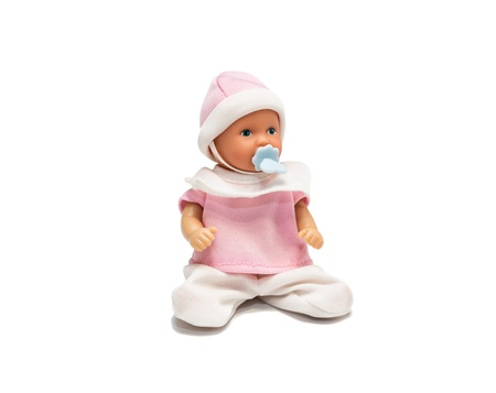 Baby doll in pink clothes isolated on white background  Studio shot Stock Photo - 18937917