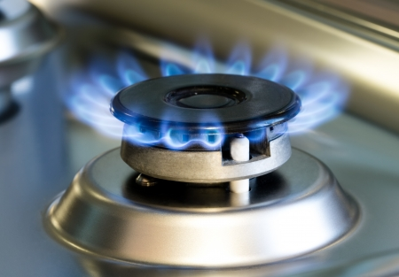 oven range: Gas stove with flames of burning gas, studio shot Stock Photo