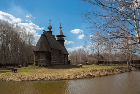 Ancient wooden temple stands on the banks of the river. Kostroma, Russia