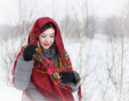 Caucasian girl walking on a snowy winter day, shooting in the open air Stock Photo