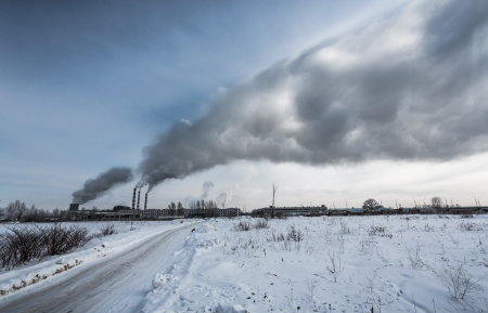 Power plant pollutes the environment, winter shot photo