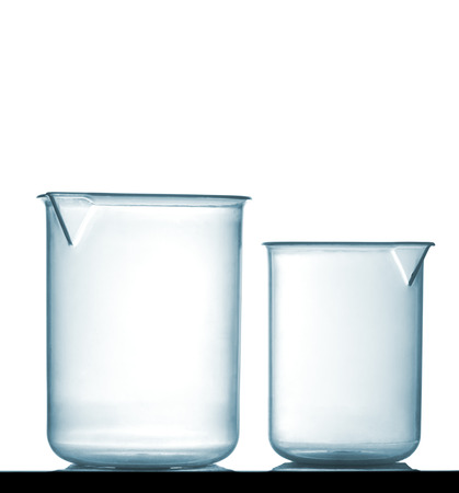 Isolated chemical plastic beakers on table with a small reflection, studio shot