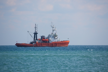 Russian fishing boat floats in the open sea, outdoors shot,  Stock Photo